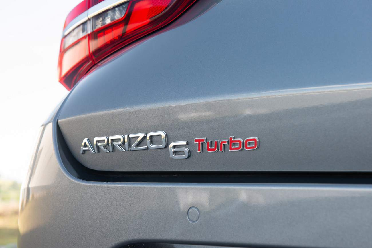 CAOA Chery Arrizo 6 logotipo